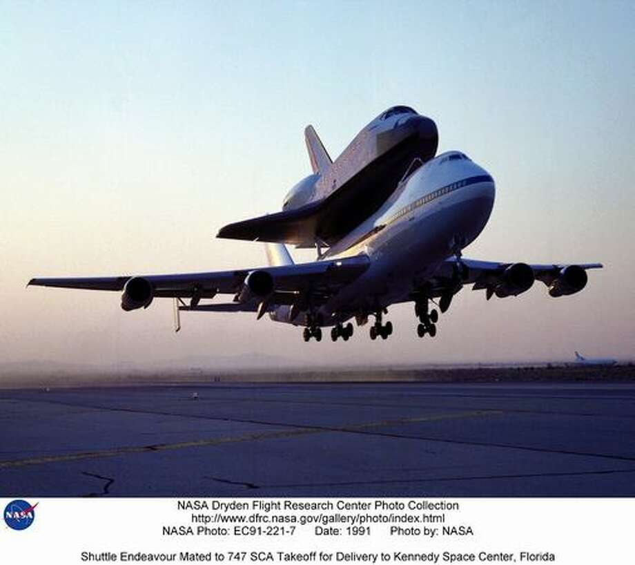 Here, NASA 747 Shuttle Carrier Aircraft takes off in 1991 with the then new Endeavour shuttle from Rockwell's Plant 42 at Palmdale, Calif., where the orbiter was built, to the Kennedy Space Center, Florida. Photo: NASA