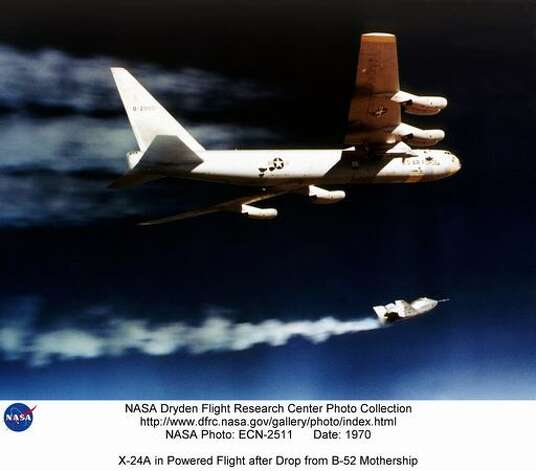 An X-24A  lights its rocket engine and begins its powered flight after being drop launched from its B-52 mothership in 1970. The X-24A was flown 28 times, and validated the concept that a Space Shuttle could be landed unpowered. The X-24B was built around the fuselage of the original X-24A, converting the bulbous shape into a 'flying flatiron' with a rounded top, flat bottom, and double delta platform that ended in a pointed nose. It demonstrated that accurate unpowered reentry vehicle landings were operationally feasible. Photo: NASA / SL