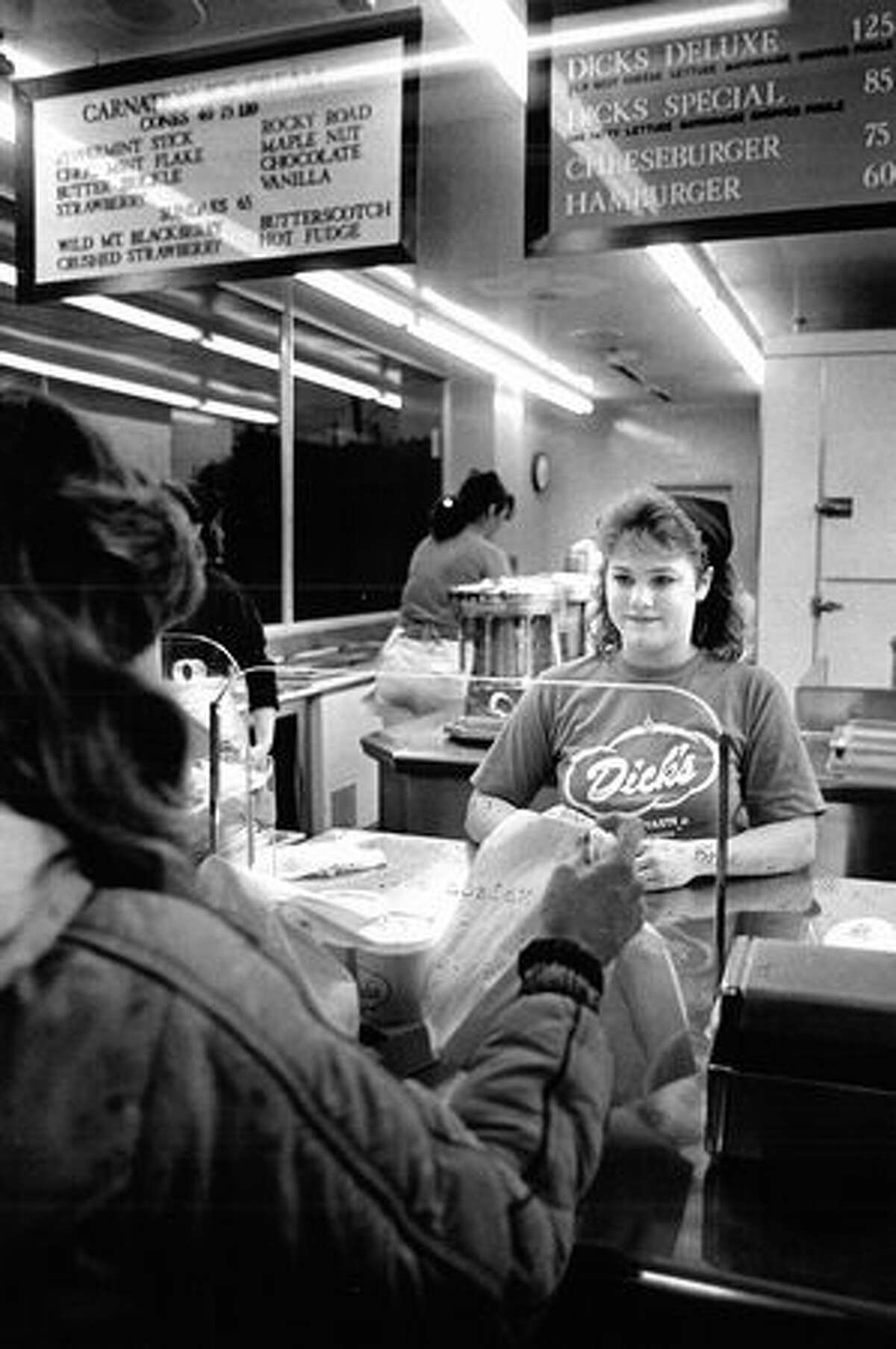 Debbie Dahms gives a customer her order during an after-school shift, March 1986. (Seattlepi.com file)
