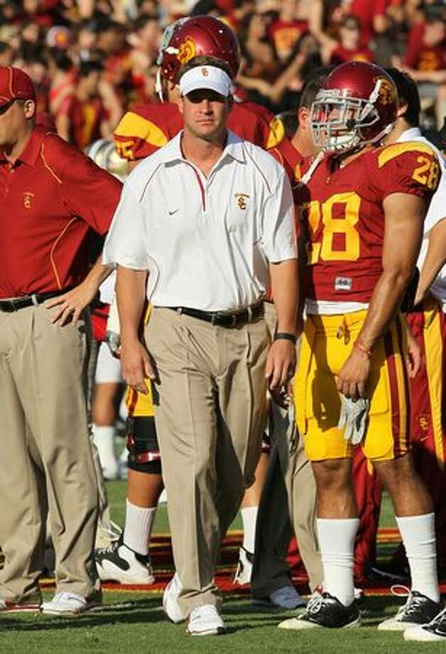 Head coach Lane Kiffin of the USC Trojans watches pregame warmups before the game with the Washington Huskies at the Los Angeles Memorial Coliseum on October 2, 2010 in Los Angeles, California. Photo: Getty Images
