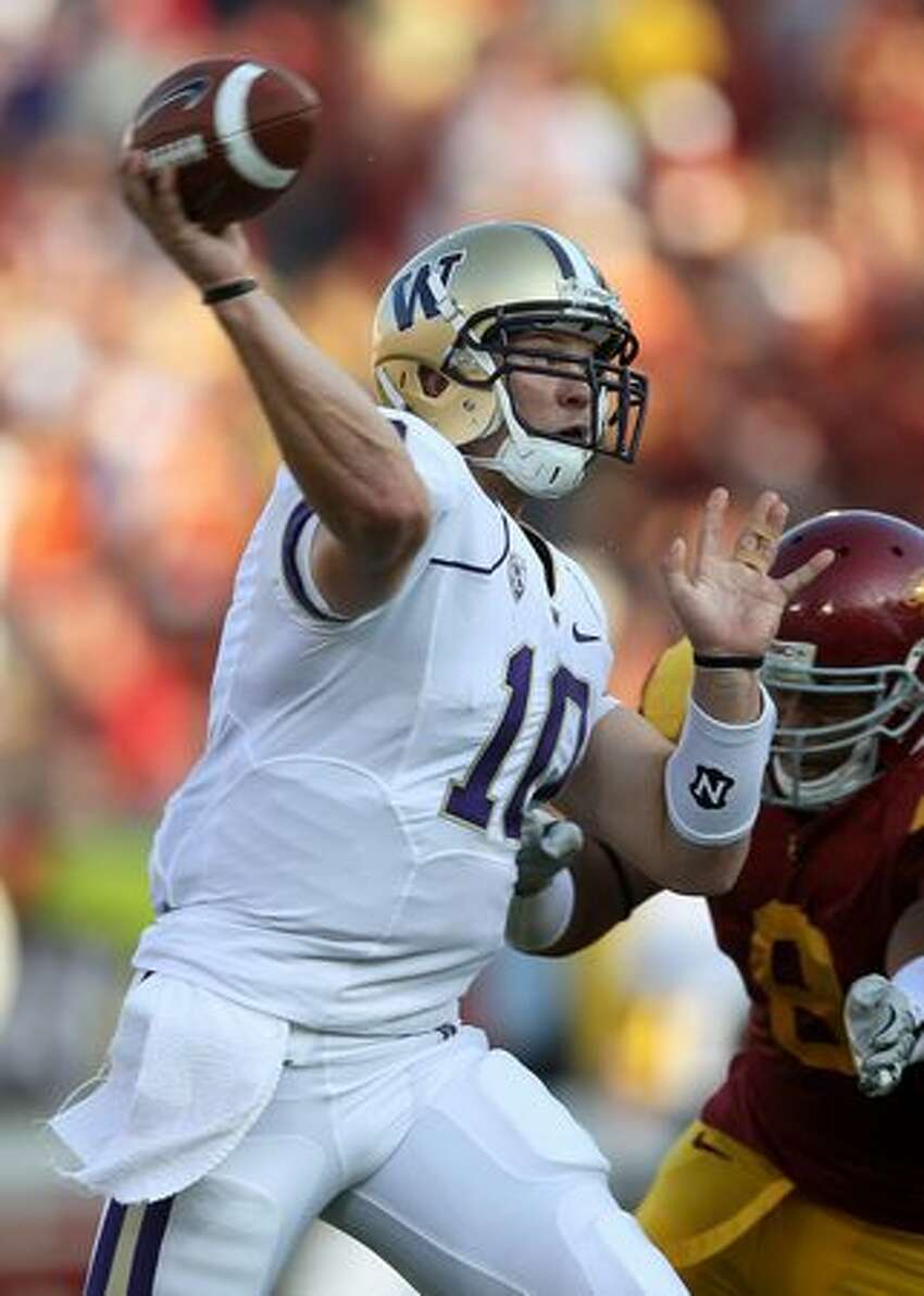 Quarterback Jake Locker #10 of the Washington Huskies throws a pass against the USC Trojans at the Los Angeles Memorial Coliseum on October 2, 2010 in Los Angeles, California.