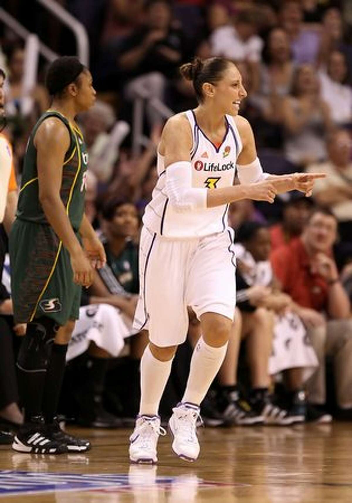 Diana Taurasi #3 of the Phoenix Mercury celebrates after hitting a three point shot against the Seattle Storm.