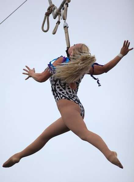A member of Circus Una spins during a performance on day three of Bumbershoot, Seattle's annual musi