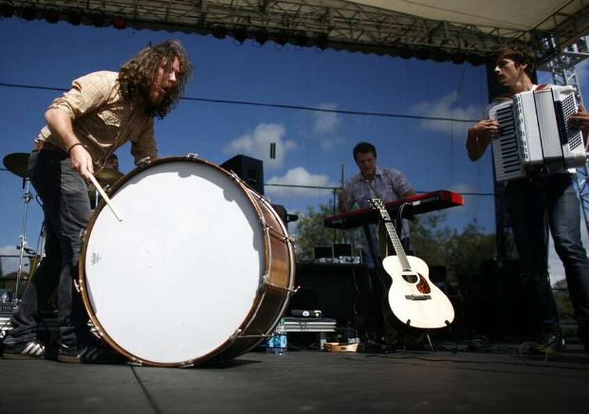 Matt Badger of the band Ravenna Woods plays a drum with local pop band Hey Marseilles on the Broad S