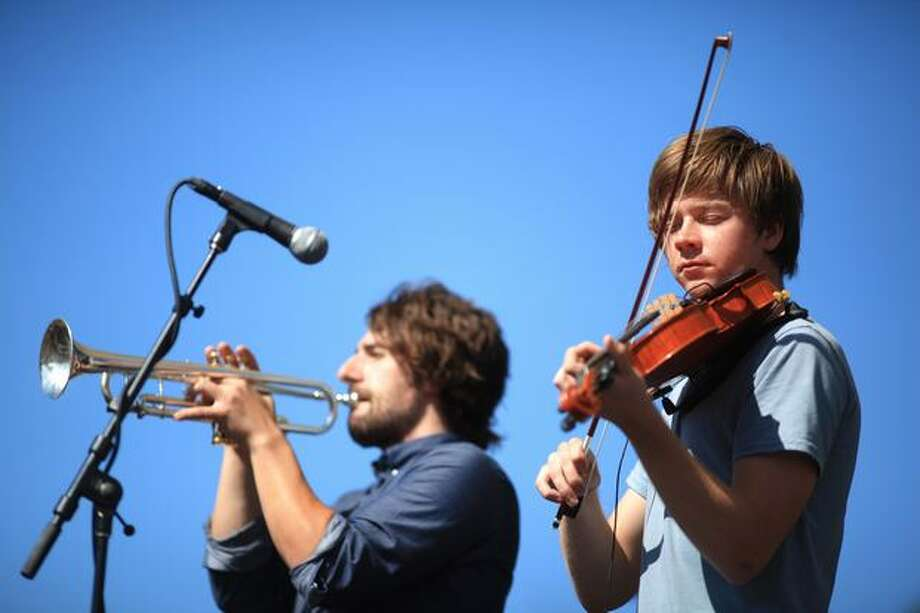 Viola player Jacob Anderson and trumpet player Patrick Brannon perform with local pop band Hey Marseilles on the Broad Street Stage. Photo: Joshua Trujillo, Seattlepi.com