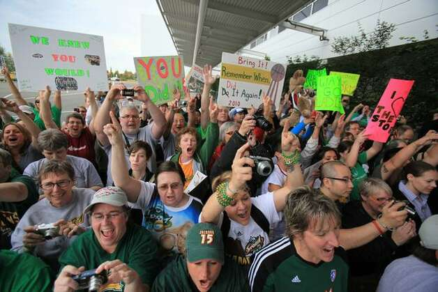 Hundreds of Seattle Storm fans greet the team at Sea-Tac International Airport after the team returned from winning the WNBA National Championship in Atlanta. Photo: Joshua Trujillo, Seattlepi.com