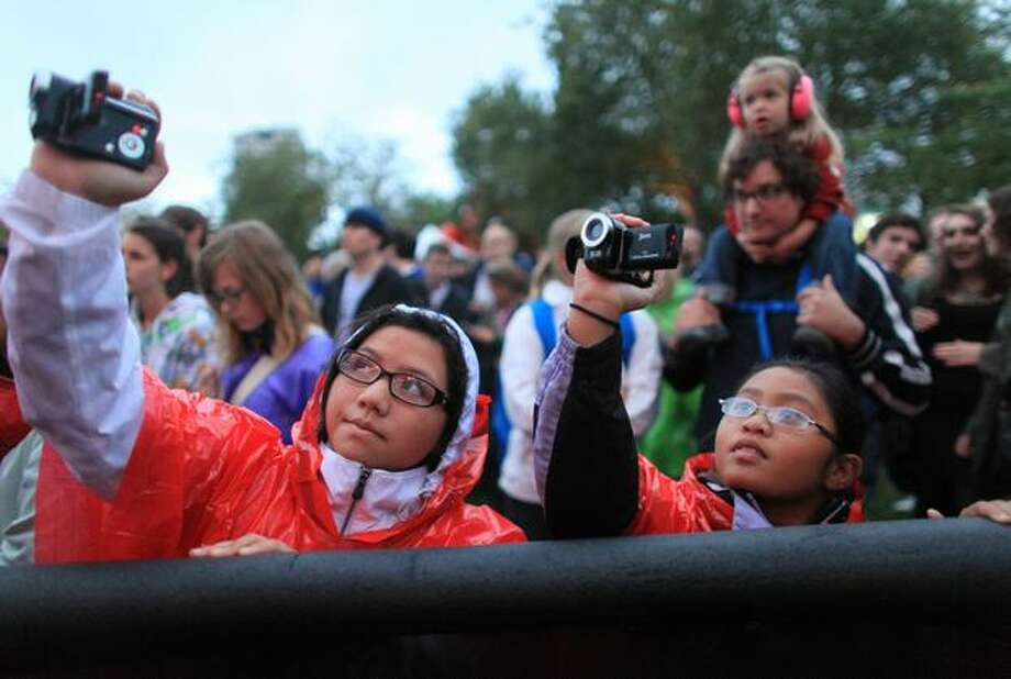 Monica Mosqueda, left, and Elena King try to get video of the band Surfer Blood at the Broad Street Stage during day three of Bumbershoot, Seattle's annual music festival, on Monday, September 6, 2010 at Seattle Center. Photo: Joshua Trujillo, Seattlepi.com