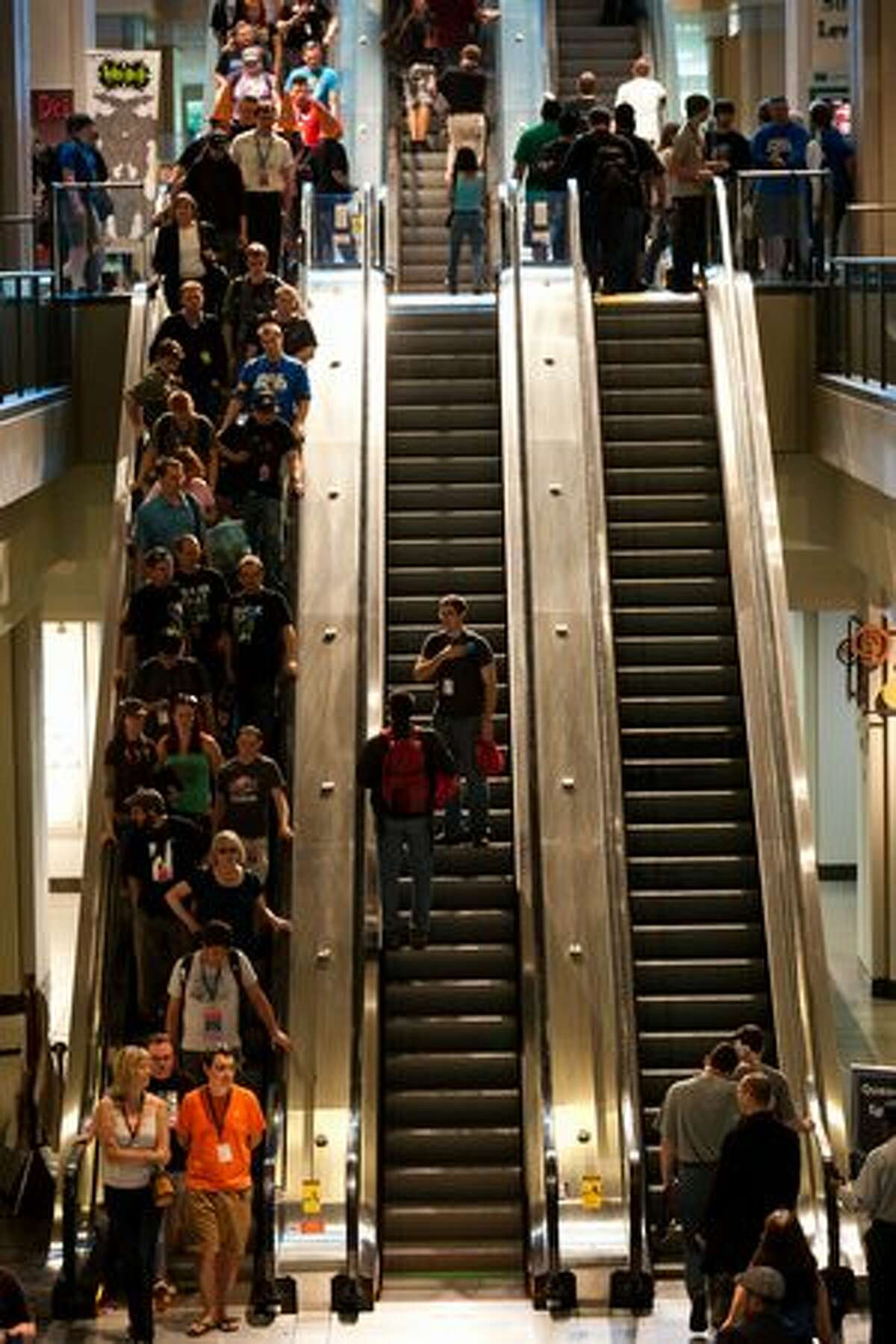 Gamers flood the escalators as they make their way through the event.