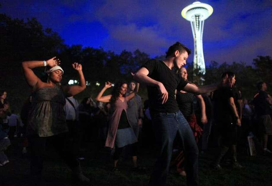 Fans dance to music by the band Balkan Beat Box. Photo: Joshua Trujillo, Seattlepi.com
