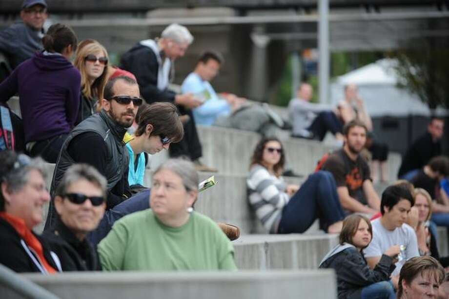 Attendees watch the Circus Una from the steps in front of the EMP. Photo: Elliot Suhr, Seattlepi.com