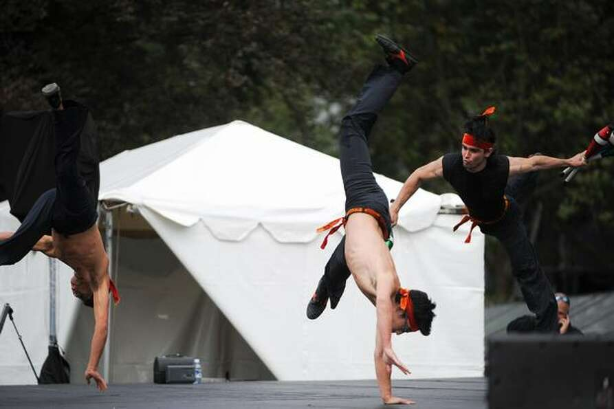 Nanda performs flip and spin as they perform a martial arts routine.