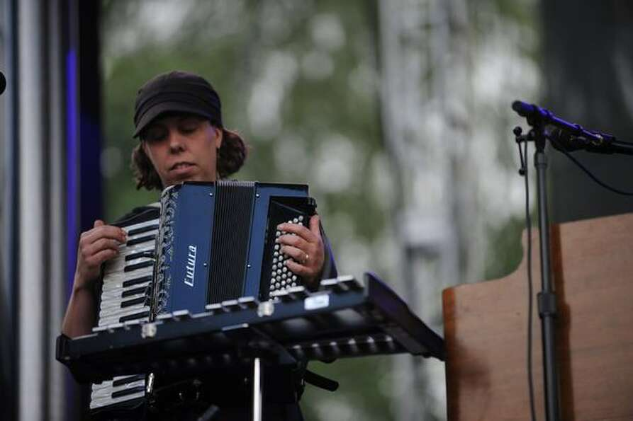 A band member plays a riff on an accordion during the show.