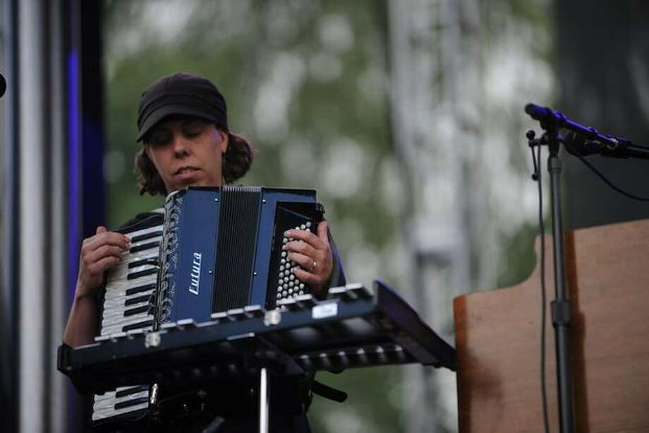 A band member plays a riff on an accordion during the show. Photo: Elliot Suhr, Seattlepi.com