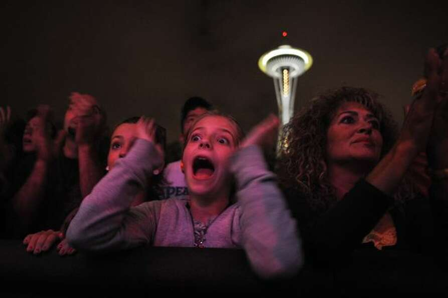 A young girl screams as Ozomatli begins their performance on the State Farm Stage.