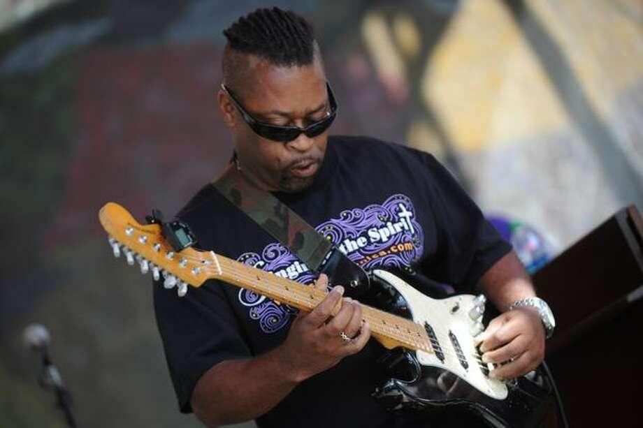 A guitarist strums a solo riff during Sista Monica's performance. Photo: Elliot Suhr, Seattlepi.com