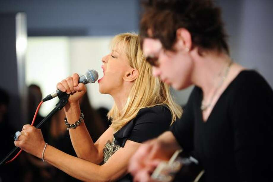 Courtney Love performs a pre-show set. Photo: Elliot Suhr, Seattlepi.com