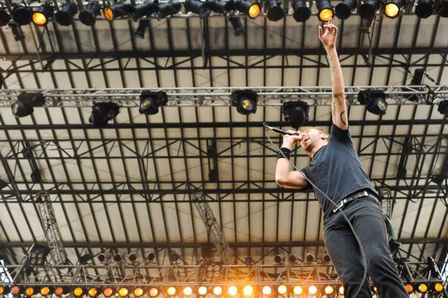 Tim McIlrath, lead vocalist of Rise Against, shouts from atop a speaker. Photo: Elliot Suhr, Seattlepi.com