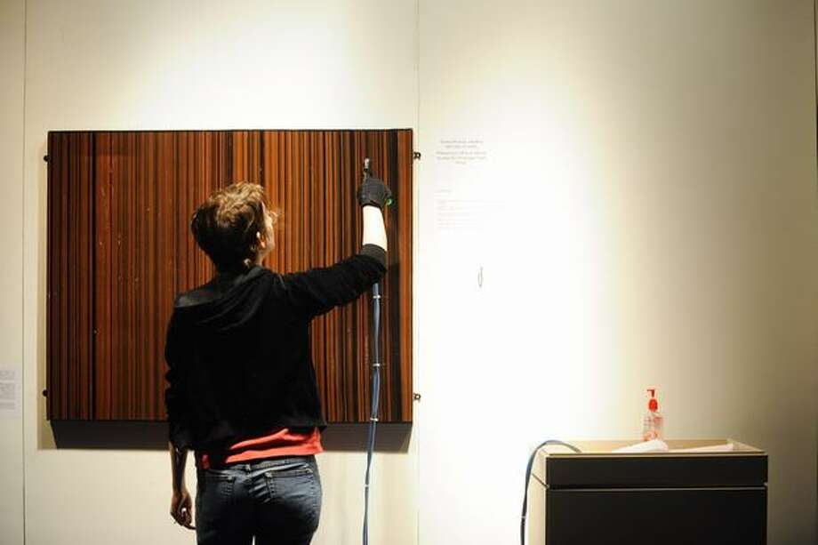 A woman interacts with the Sounds Human exhibit in the Lopez Room. Photo: Elliot Suhr, Seattlepi.com