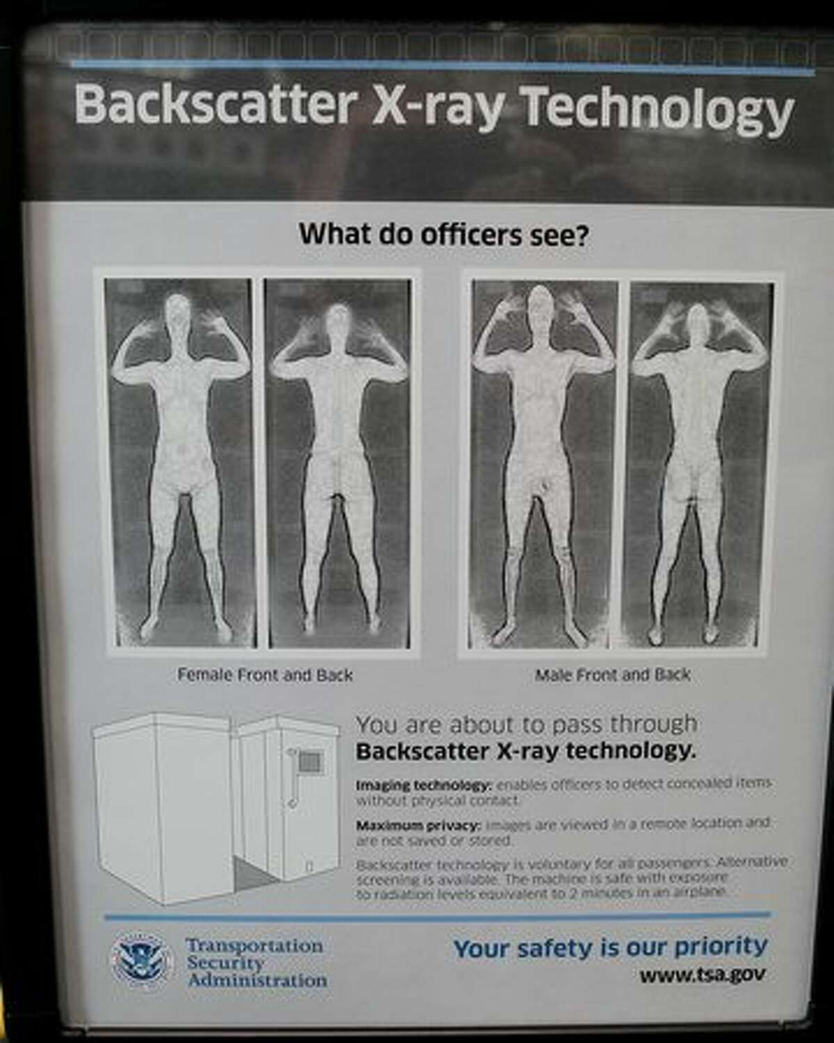 A sign at a Transportation Security Administration checkpoint instructs passengers about the use of the full-body scanner at Chicago O'Hare International Airport.