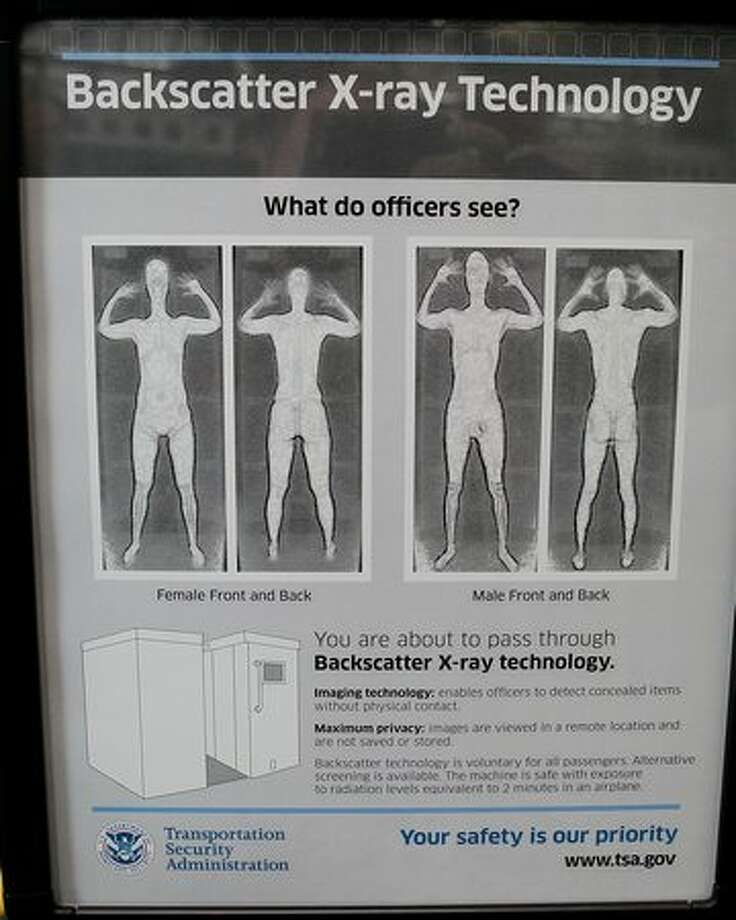 A sign at a Transportation Security Administration checkpoint instructs passengers about the use of the full-body scanner at Chicago O'Hare International Airport. Photo: Getty Images