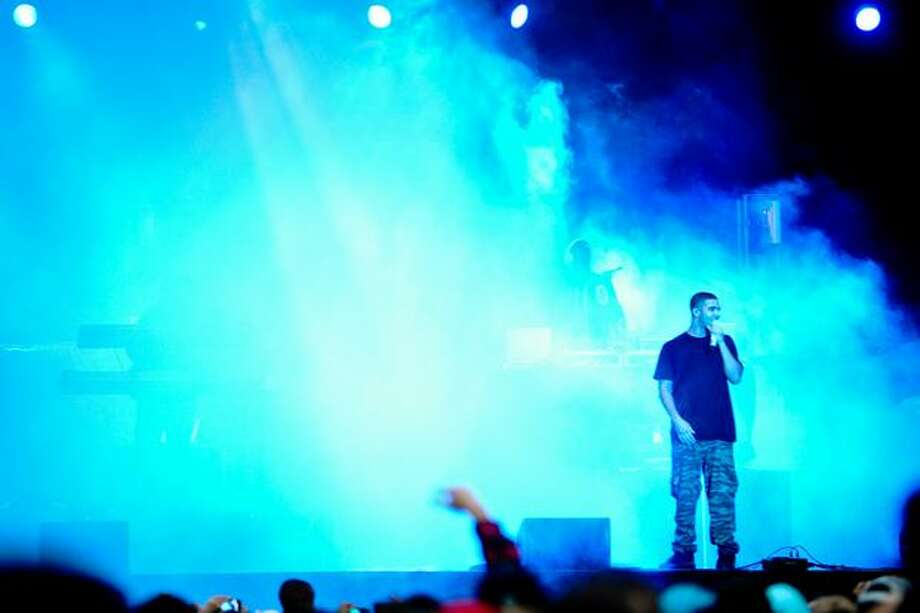 Drake performs as fog machines cloud the stage. Photo: Elliot Suhr, Seattlepi.com
