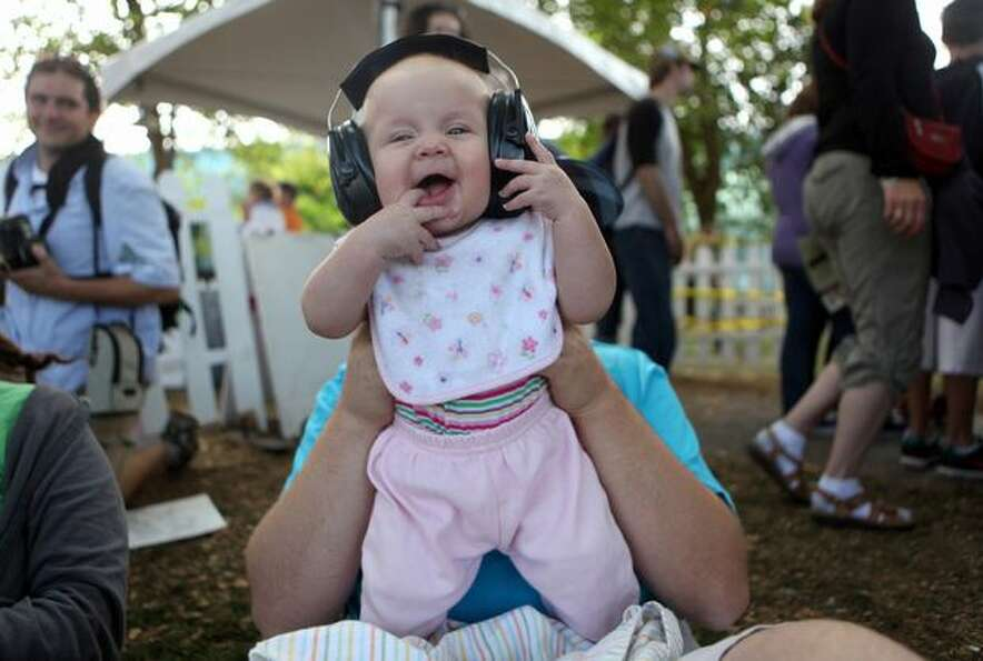 Four-month-old Rachel Hobbs enjoys David Bazan's performance at Bumbershoot on Sunday.