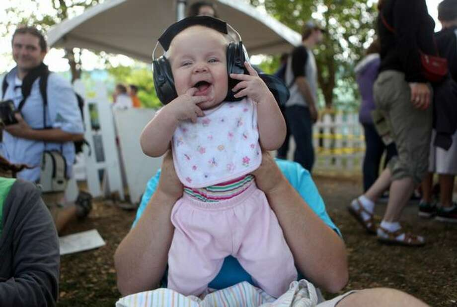Four-month-old Rachel Hobbs enjoys David Bazan's performance at Bumbershoot on Sunday. Photo: Cliff DesPeaux, Special To Seattlepi.com