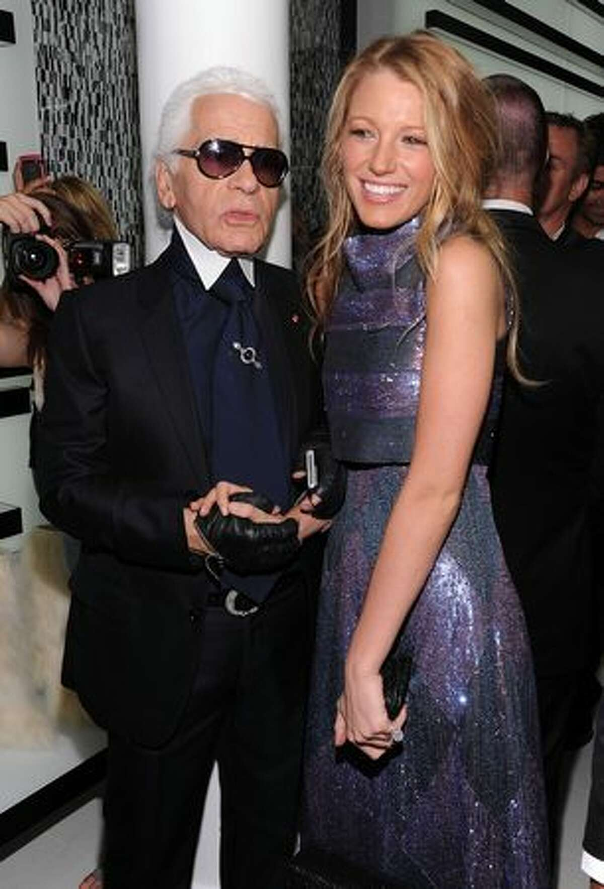 Designer Karl Lagerfeld and actress Blake Lively attend the reopening of the CHANEL SoHo Boutique at the Chanel Boutique Soho in New York City.