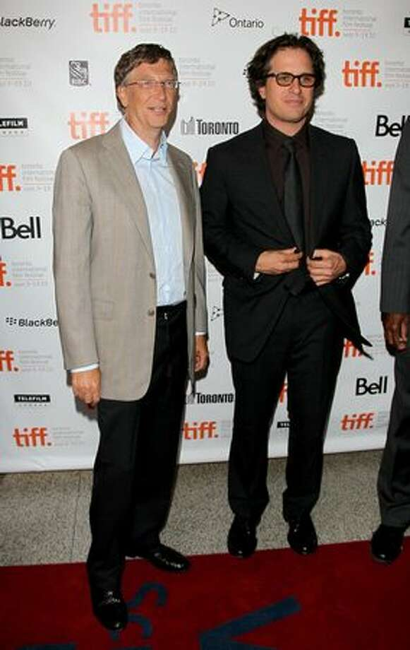 """Bill Gates (L), director Davis Guggenheim arrive at the """"Waiting For Superman"""" Premiere held at the Winter Garden Theatre during the 35th Toronto International Film Festival in Toronto, Canada. Photo: Getty Images"""