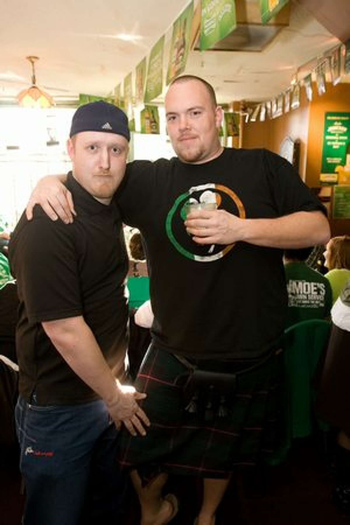 Patrons celebrate St. Patrick's Day at the Owl'n Thistle Irish pub in downtown Seattle.