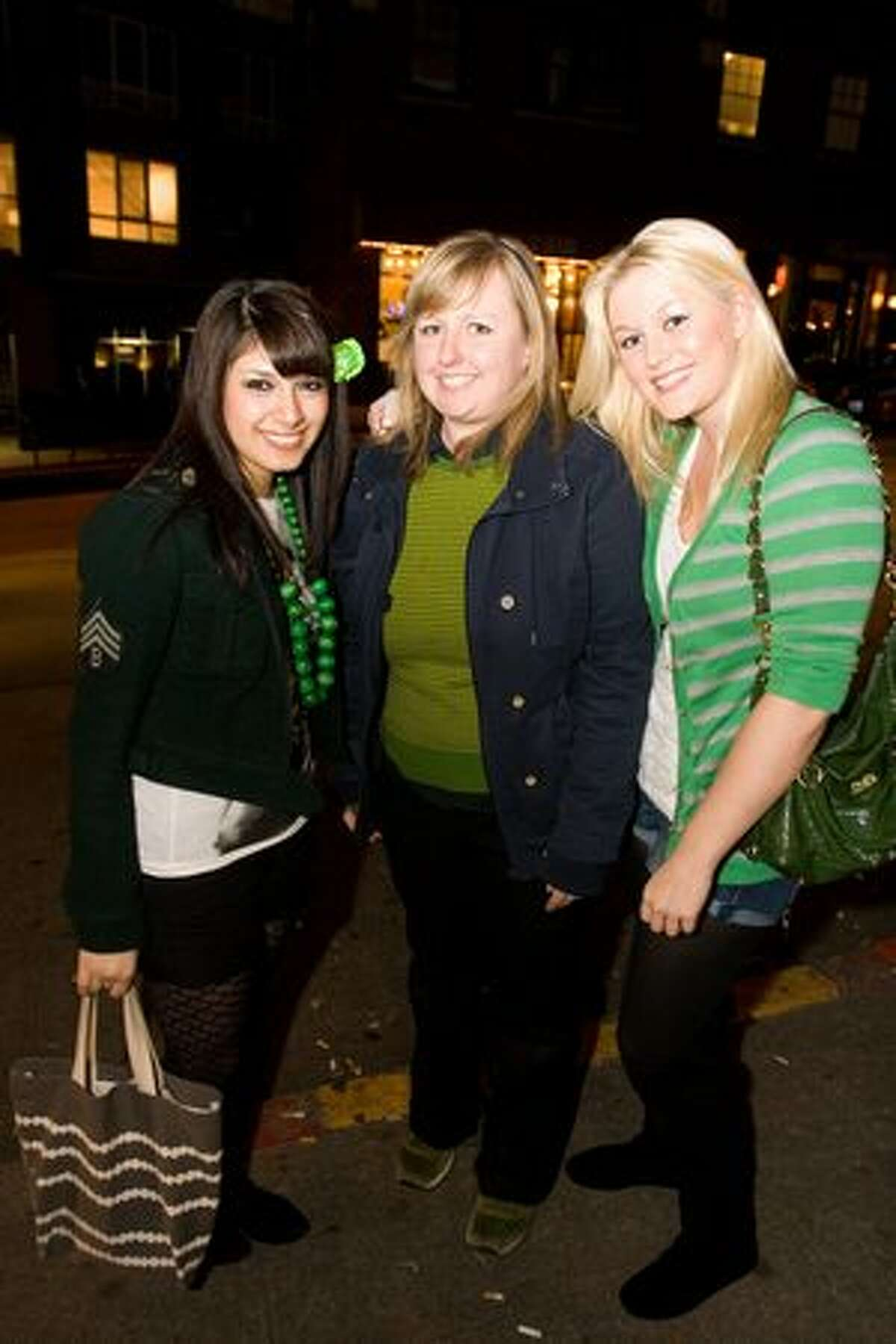 Patrons celebrate St. Patrick's Day at Clever Dunne's Irish pub in Capitol Hill.