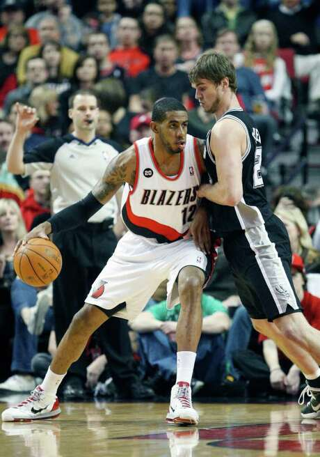 San Antonio Spurs' Tiago Splitter, right, of Brazil, defends against Portland Trail Blazers' LaMarcus Aldridge (12) in the first quarter during their NBA basketball game Friday, March 25, 2011, in Portland, Ore. Photo: AP
