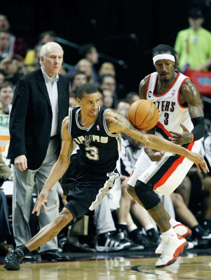 Portland Trail Blazers' Gerald Wallace (3) steals a pass from San Antonio Spurs' George Hill (3) in the second quarter during their NBA basketball game Friday, March 25, 2011, in Portland, Ore. Photo: AP
