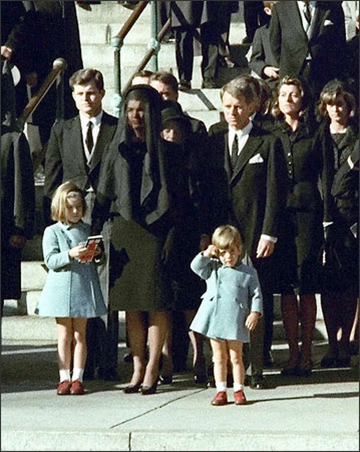 Three-year-old John F. Kennedy Jr. salutes his father's casket in Washington in this Nov. 25, 1963 file photo, three days after the president was assassinated in Dallas. Widow Jacqueline Kennedy, center, and daughter Caroline Kennedy are accompanied by the late president's brothers, Sen. Edward Kennedy, left, and Attorney General Robert Kennedy. (AP Photo/FILE) Photo: Associated Press