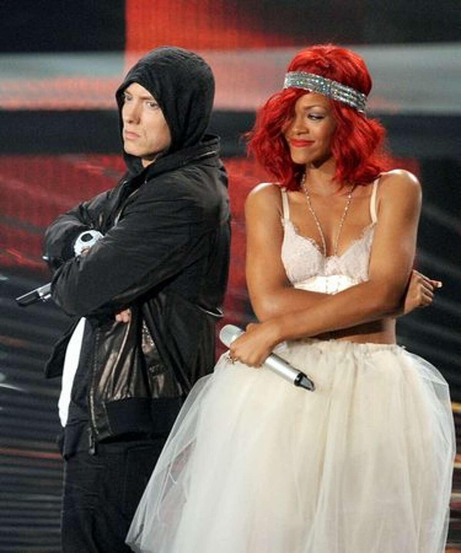 Rapper Eminem (L) and singer Rihanna performs onstage.