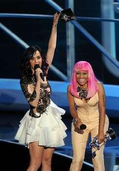 Singers Katy Perry (L) and Nicki Minaj speak onstage. Photo: Getty Images