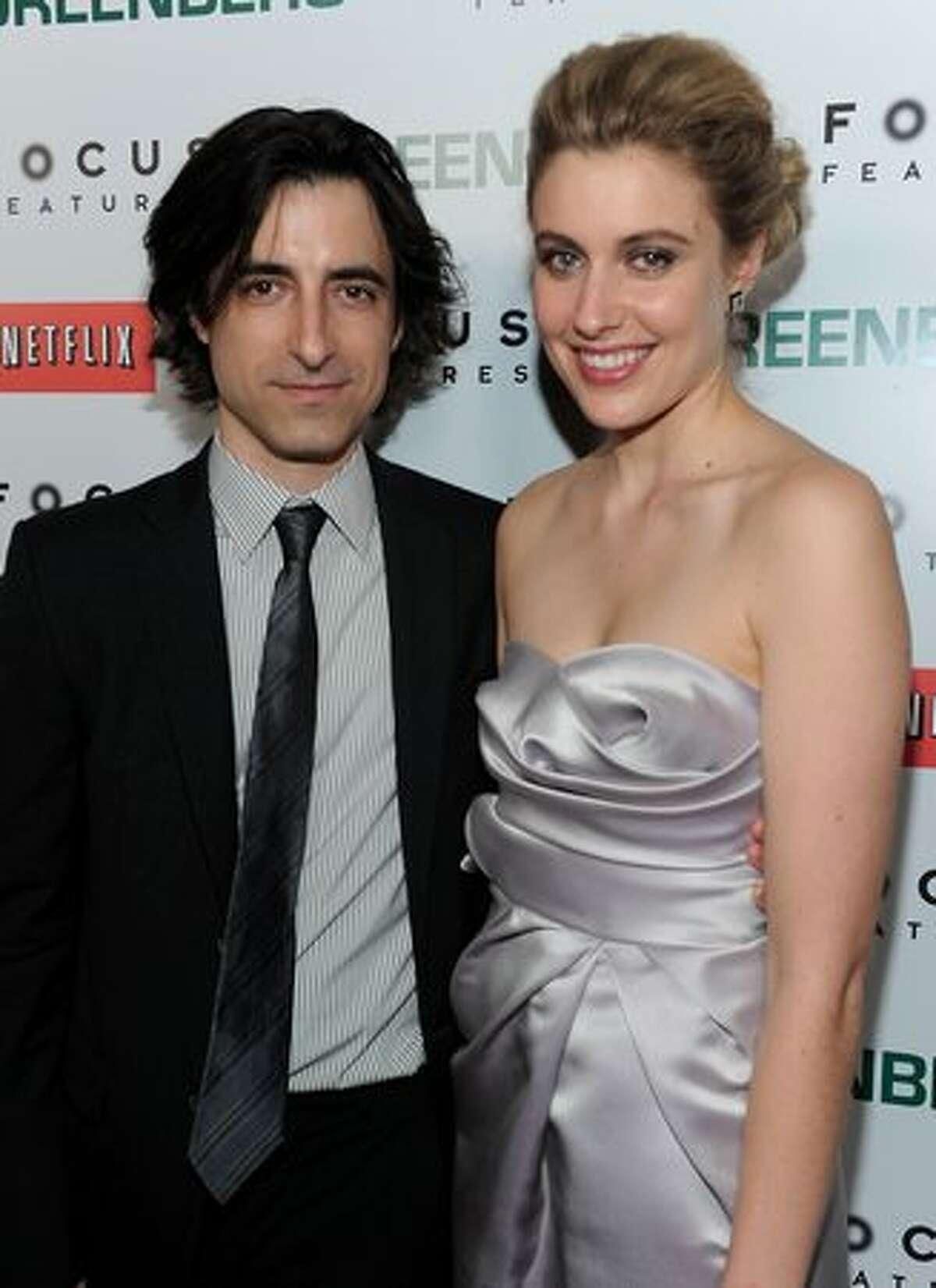 Director Noah Baumbach and actress Greta Gerwig arrive on the red carpet at the