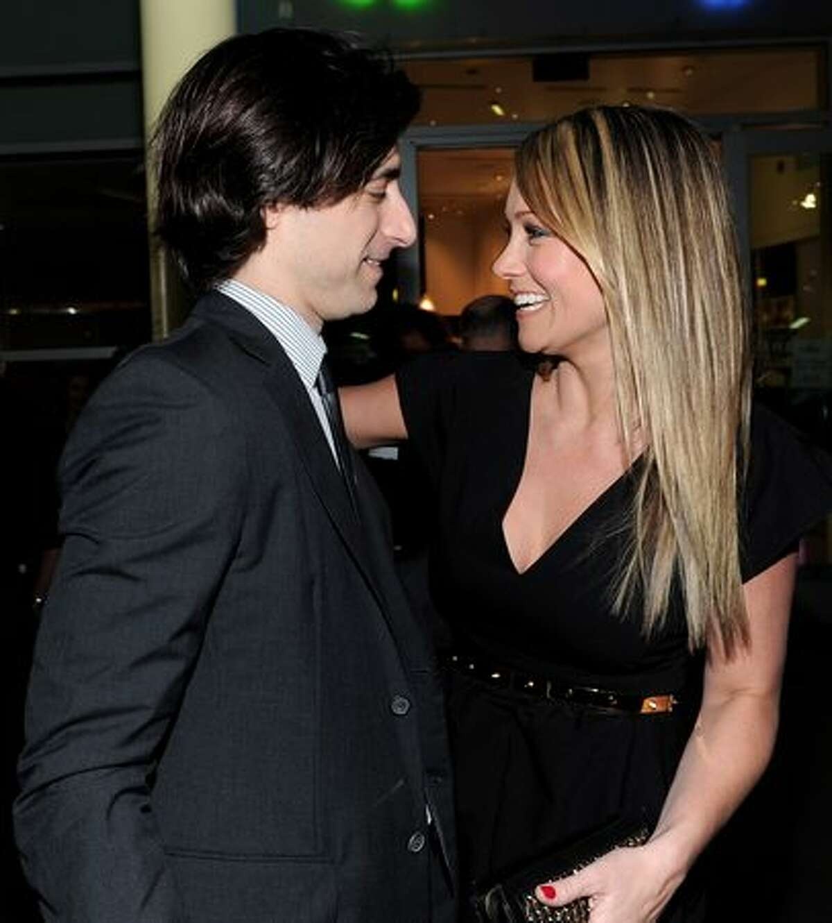 Director Noah Baumbach and actress Christine Taylor arrive on the red carpet at the