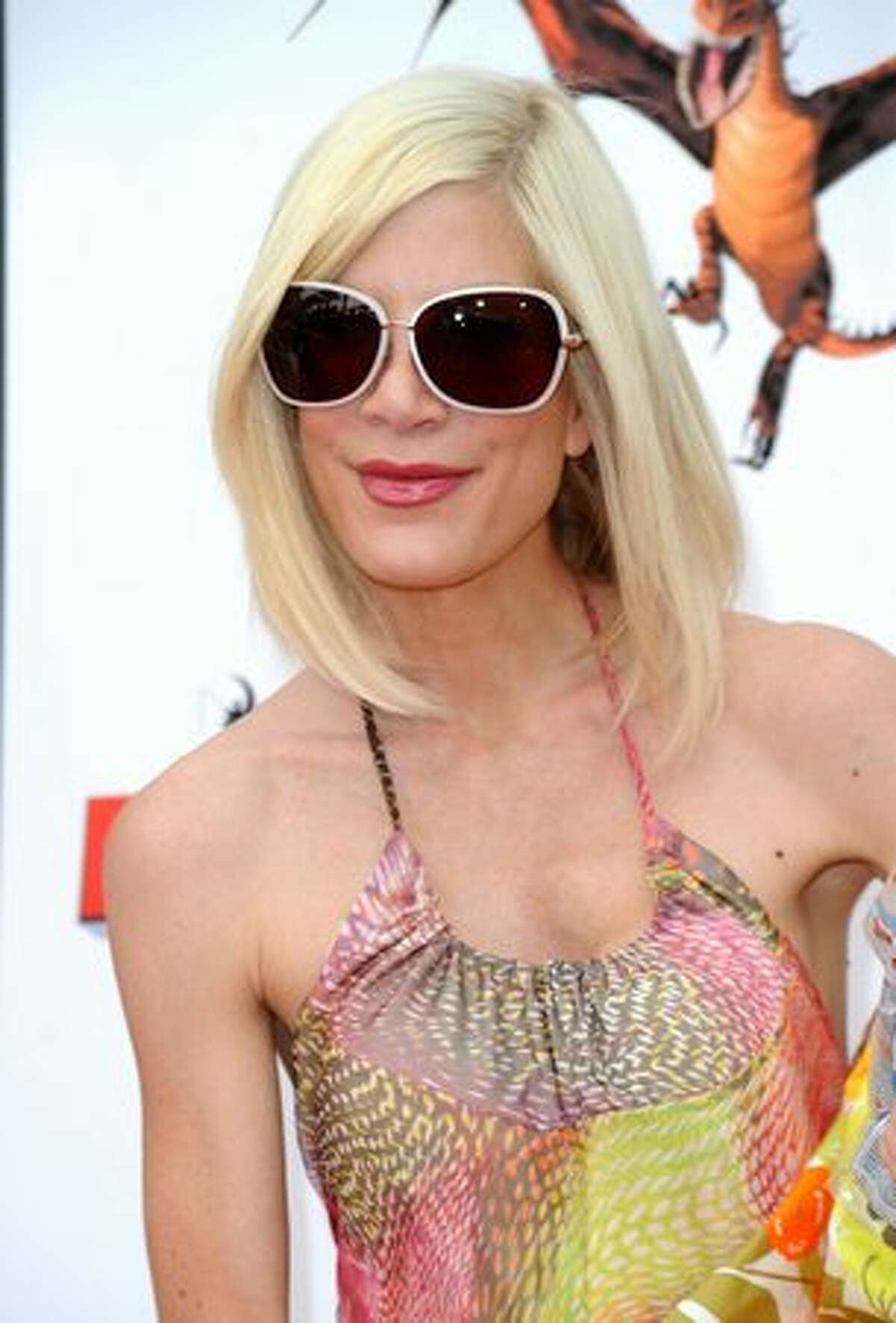 """Actress Tori Spelling arrives at the premiere of Dreamworks Animation's """"How To Train Your Dragon"""" at Gibson Amphitheatre in Universal City, California."""
