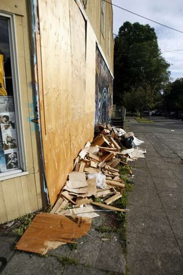 Plywood patches the hole in Golden Oldies Records and Tapes. An SUV drove through the west wall of the Wallingford store the morning of August 8. Photo: Casey McNerthney, Seattlepi.com