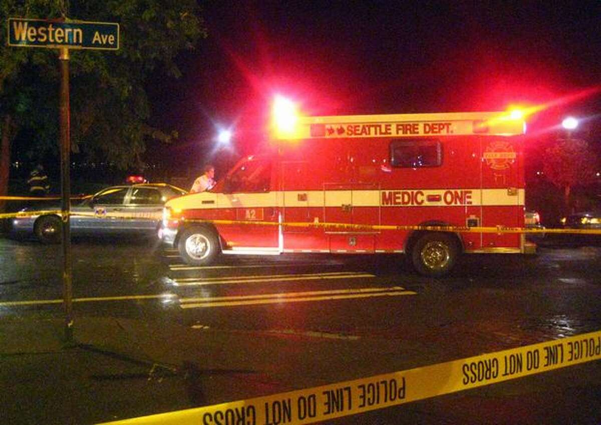 A medic unit at the scene of a September 15 triple stabbing near Western Avenue and Virginia Street. Read more here.