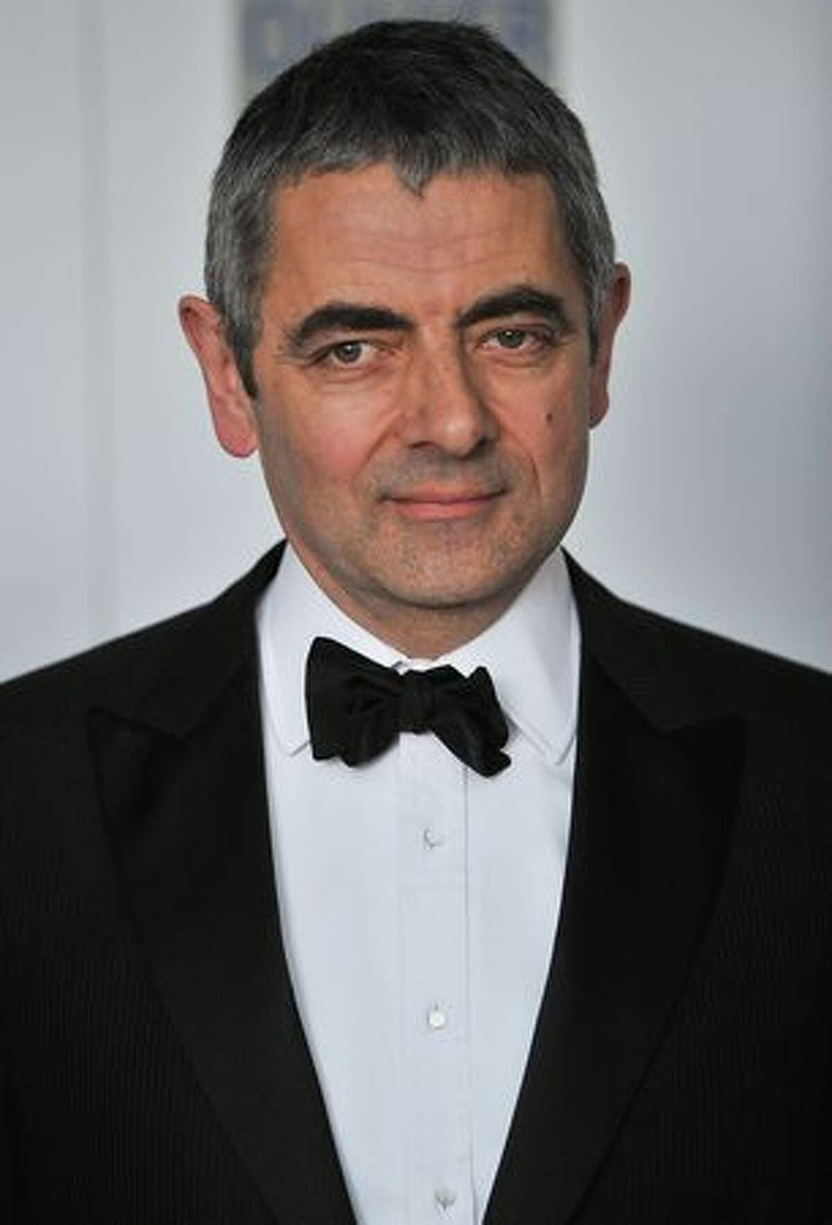 British actor Rowan Atkinson arrives in central London ahead of the Laurence Olivier theatre awards.