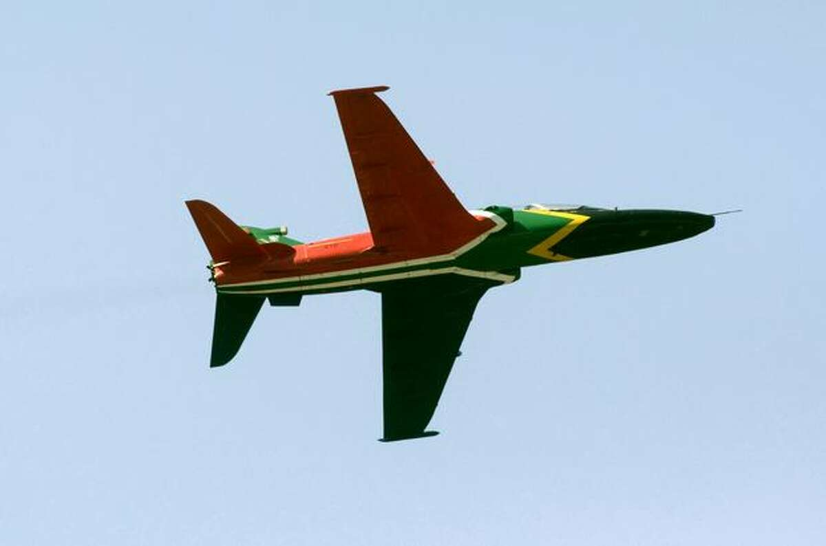 A South African Air Force Hawk trainer painted in the national colors flies during the Africa Aeronautics and Defence Airshow, at Ysterplaat Airforce Base in Cape Town, South Africa.