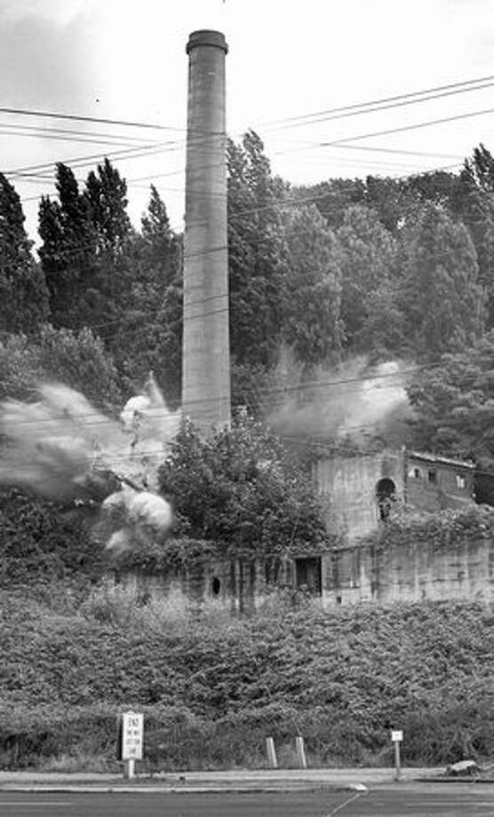 The photo caption, written in 1964, read: 150 sticks of dynamite explode at the base of an incinerator tower, built in 1911, which was being cleared to make way for a freeway. Photo: P-I File