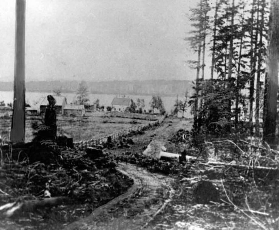 When this photo ran in the Seattle Post-Intelligencer, the caption read: This is what the Madison Park site looked like in the 1860s or early 1870s, with home and farm sites being carved out of tall, straight stands of evergreens overlooking Lake Washington. This photo shows the Oliver McGilvra home in the background. At this time, Seattle encompassed about 10 square miles. Photo: P-I File
