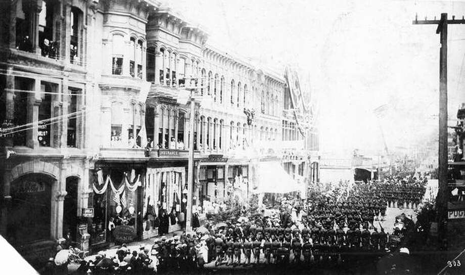 This photo, showing a parade in what appears to be Pioneer Square, was in the P-I's general history photo. But it contains no photo caption or additional information about the event. Photo: P-I File