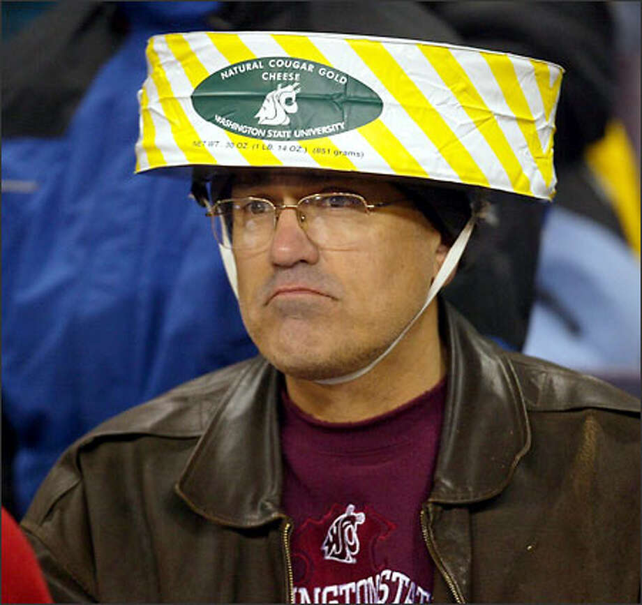 A Cougar fan's version of the Cheesehead fan--The Cougar Gold Cheesehead fan. Photo: Grant M. Haller, Seattle Post-Intelligencer