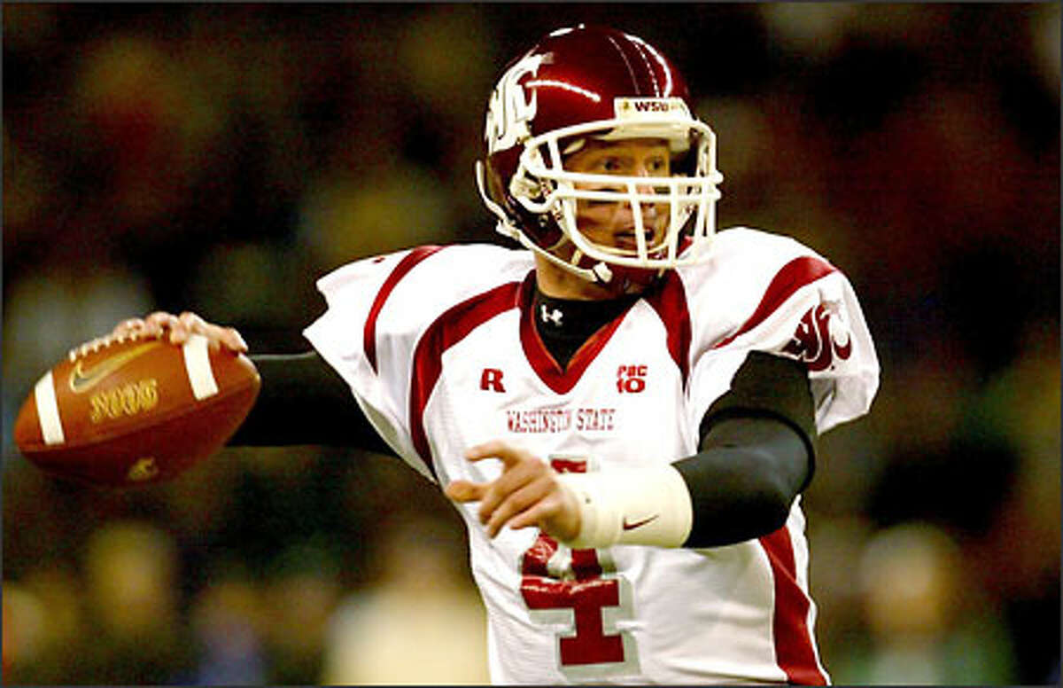 WSU's quarterback Matt Kegel (4) at work against the Huskies in the first half.