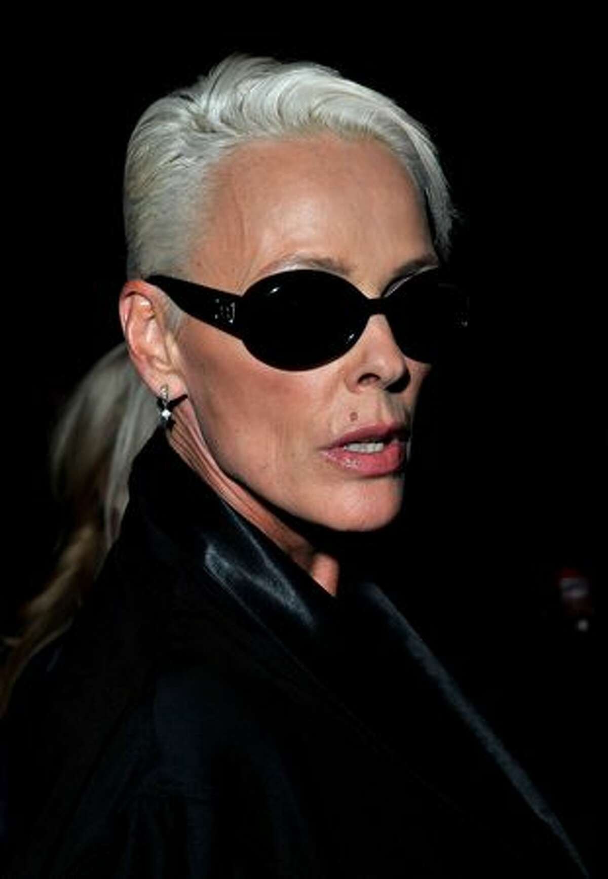 Brigitte Nielsen attends the PPQ Spring/Summer 2011 fashion show during LFW at Somerset House in London, England.