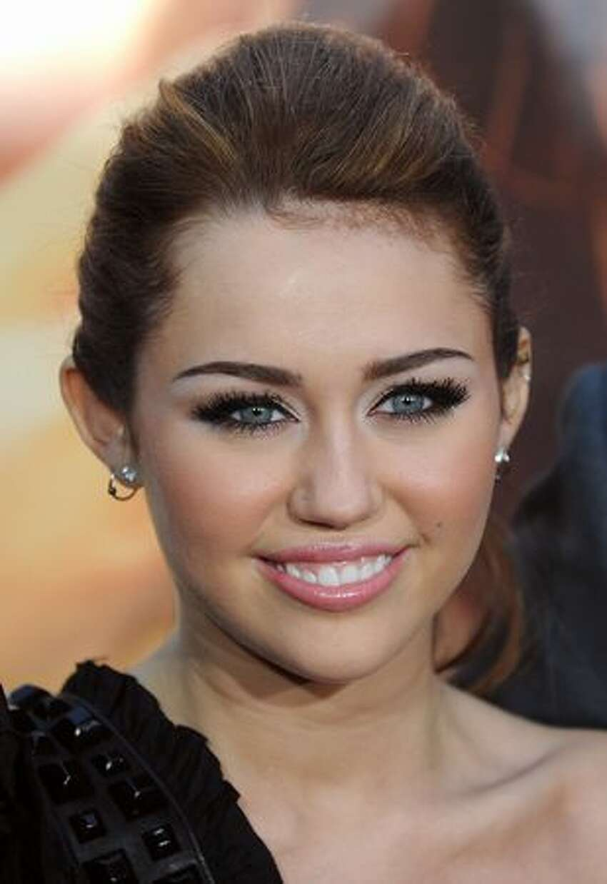 Actress and singer Miley Cyrus arrives for the premiere of